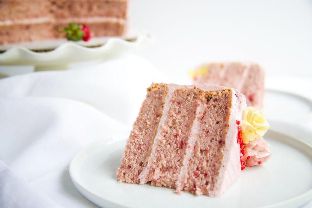Fresh Strawberry Cake slice on a white plate
