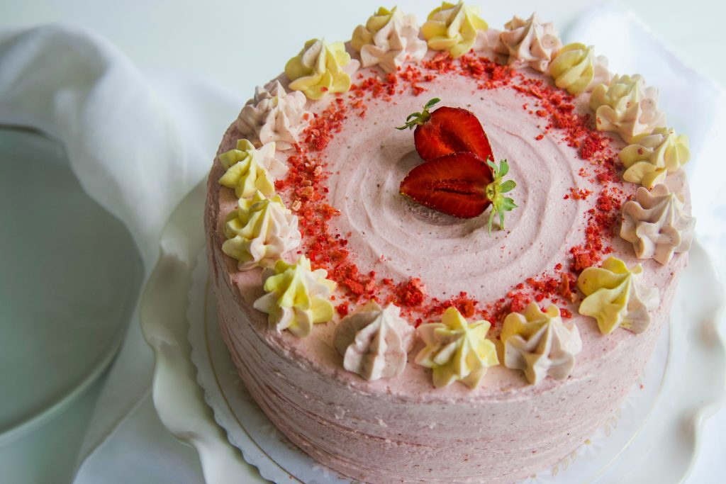 Fresh Strawberry Cake with fresh strawberries and strawberry frosting