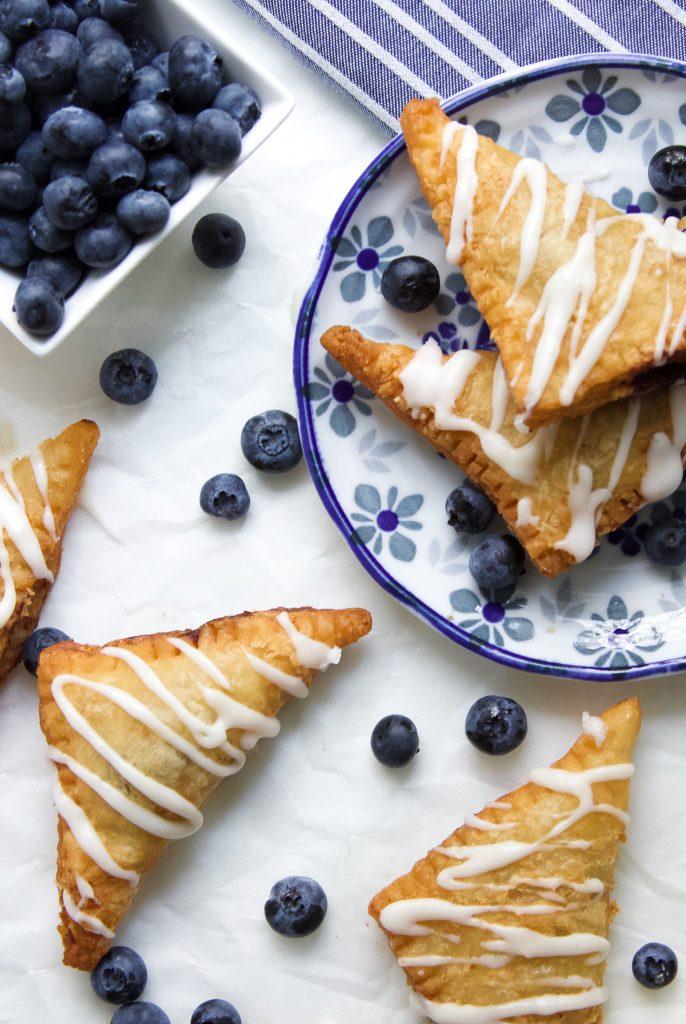 Fried Blueberry Pies with Lemon Cream Glaze