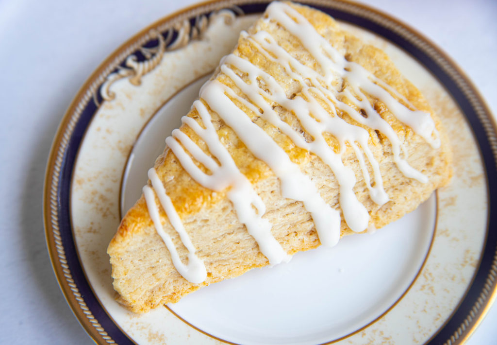 Cardamom Brown Sugar Scones with Lemon Glaze on a plate