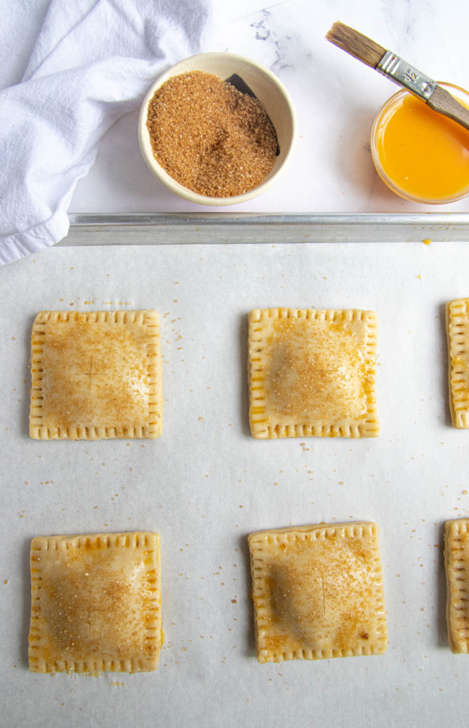Brushing the Rhubarb Hand Pies with Egg Wash