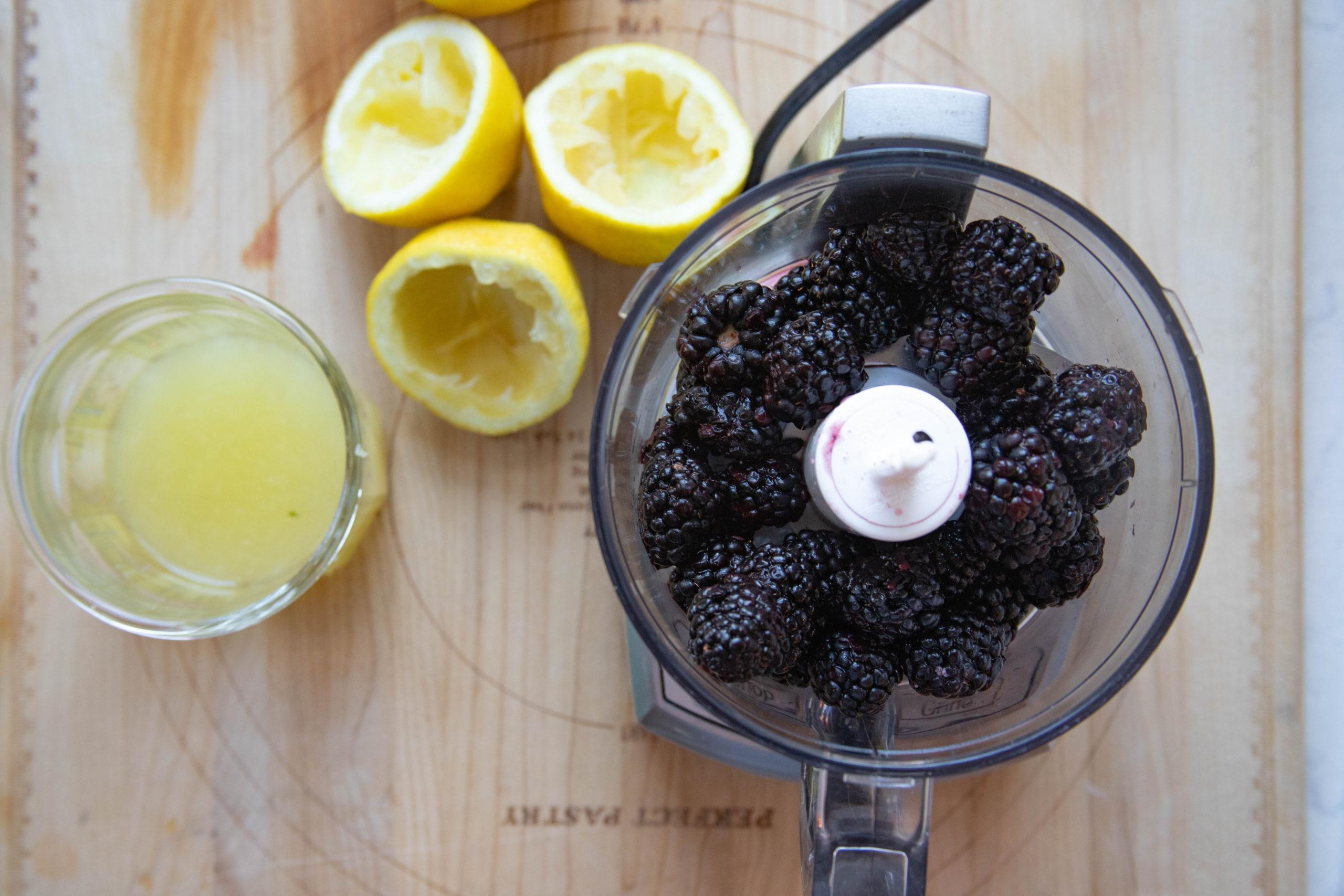Blackberry Curd Ingredients - fresh squeezed lemon juice and fresh blackberries in food processor