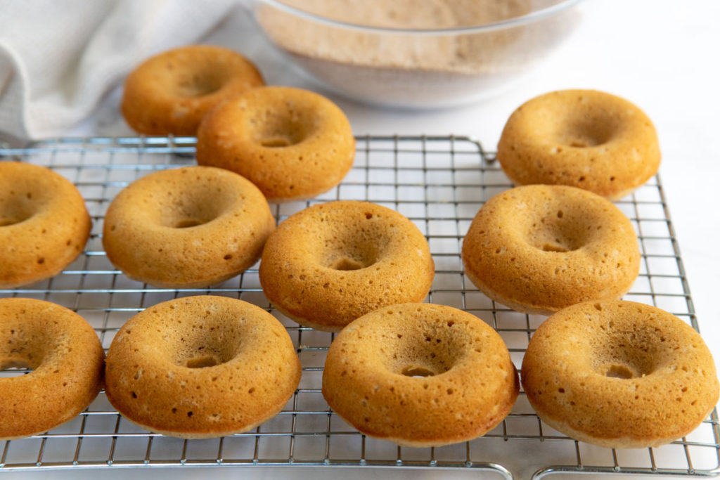 Baked Apple Cider Doughnuts Arranged on Cooling Rack