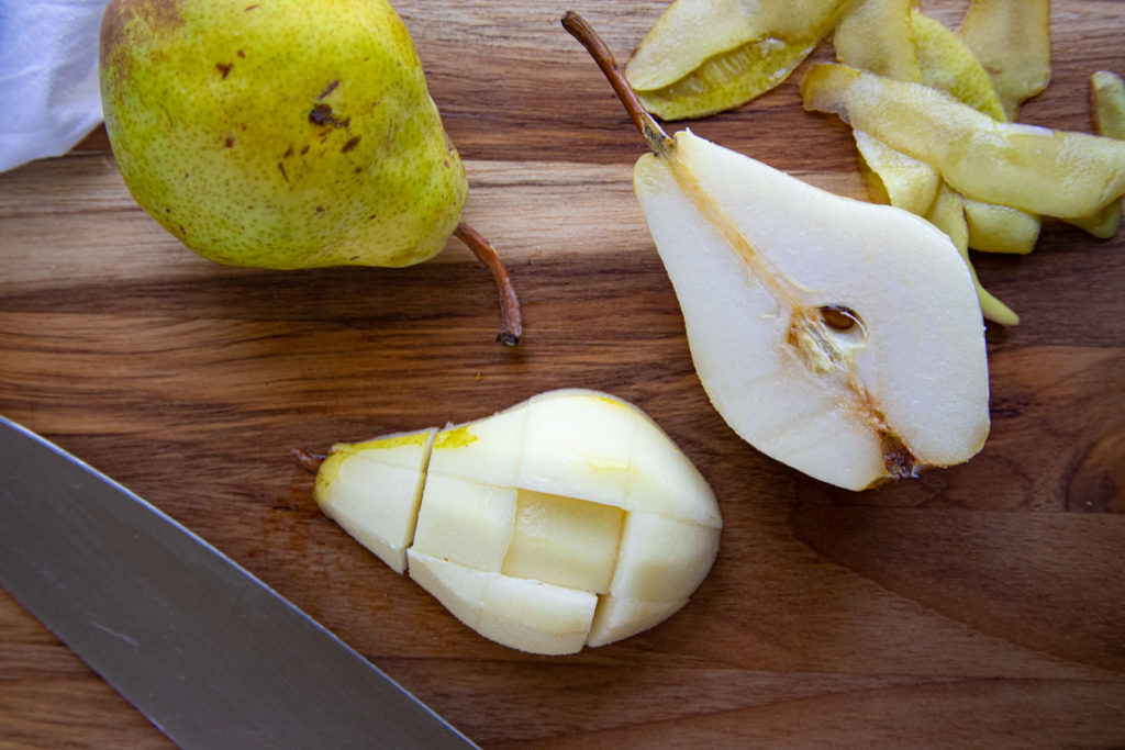 One whole pear and one pear peeled, cut in half and chopped intp large chunks