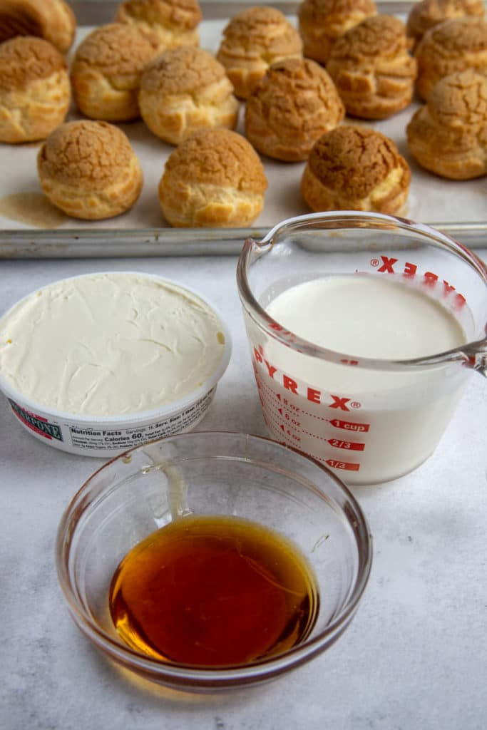 Mascarpone, Heavy Cream and Honey with baked choux buns in the background