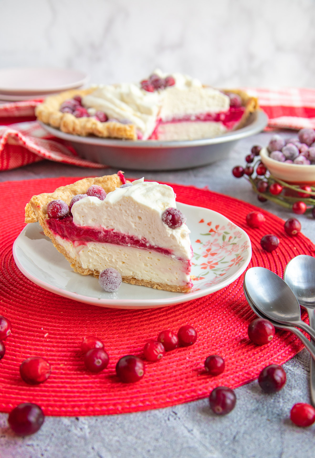 Slice of cranberry cheesecake pie on a plate