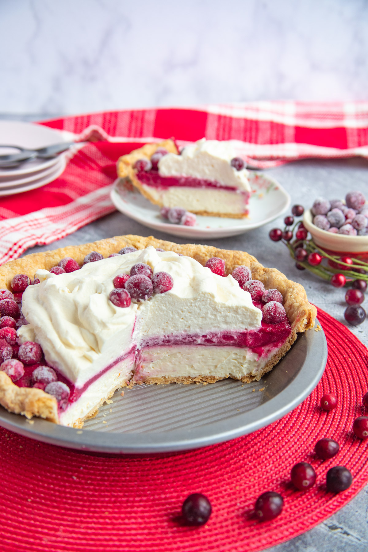 Cheesecake Cranberry Pie in pie plate and slice on a small plate
