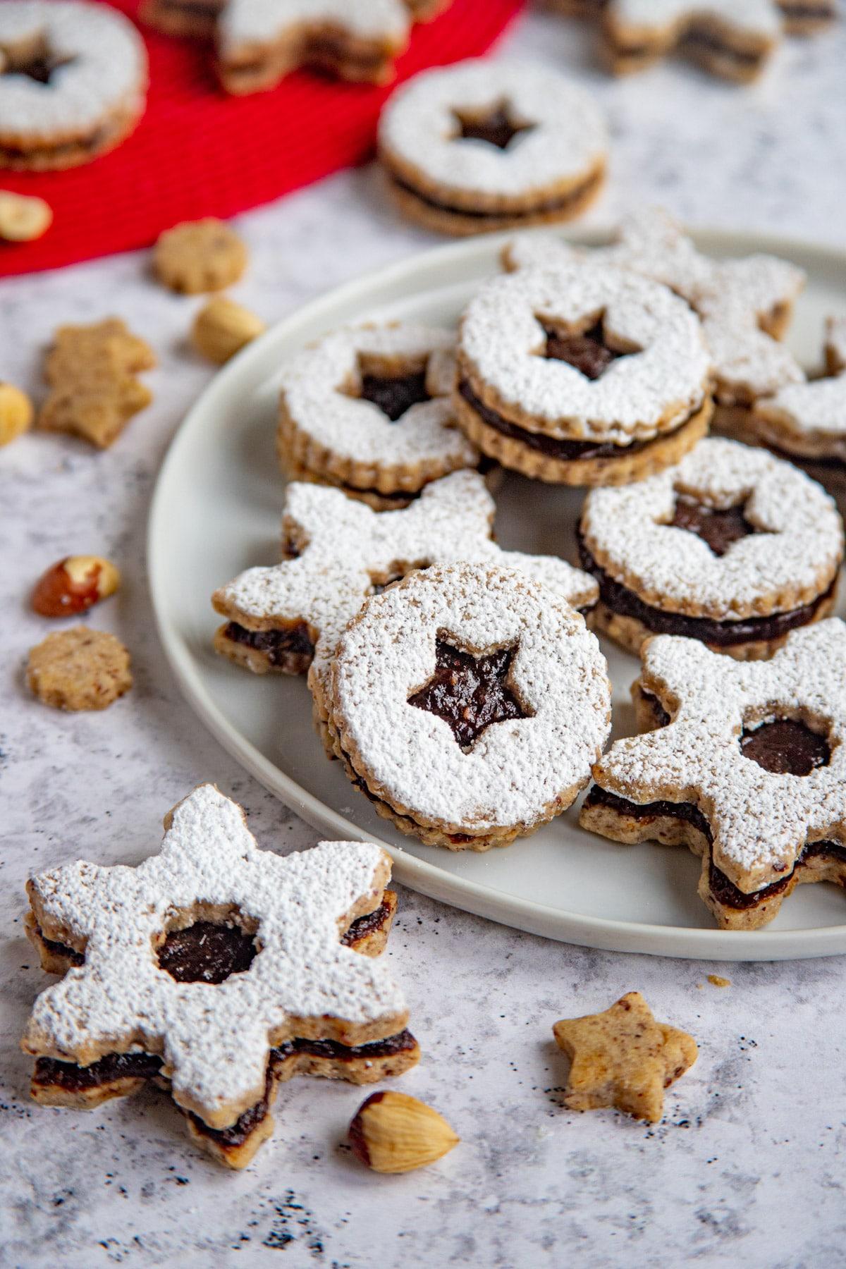 Hazelnut Linzer Prune Jam Cookies on a white plate