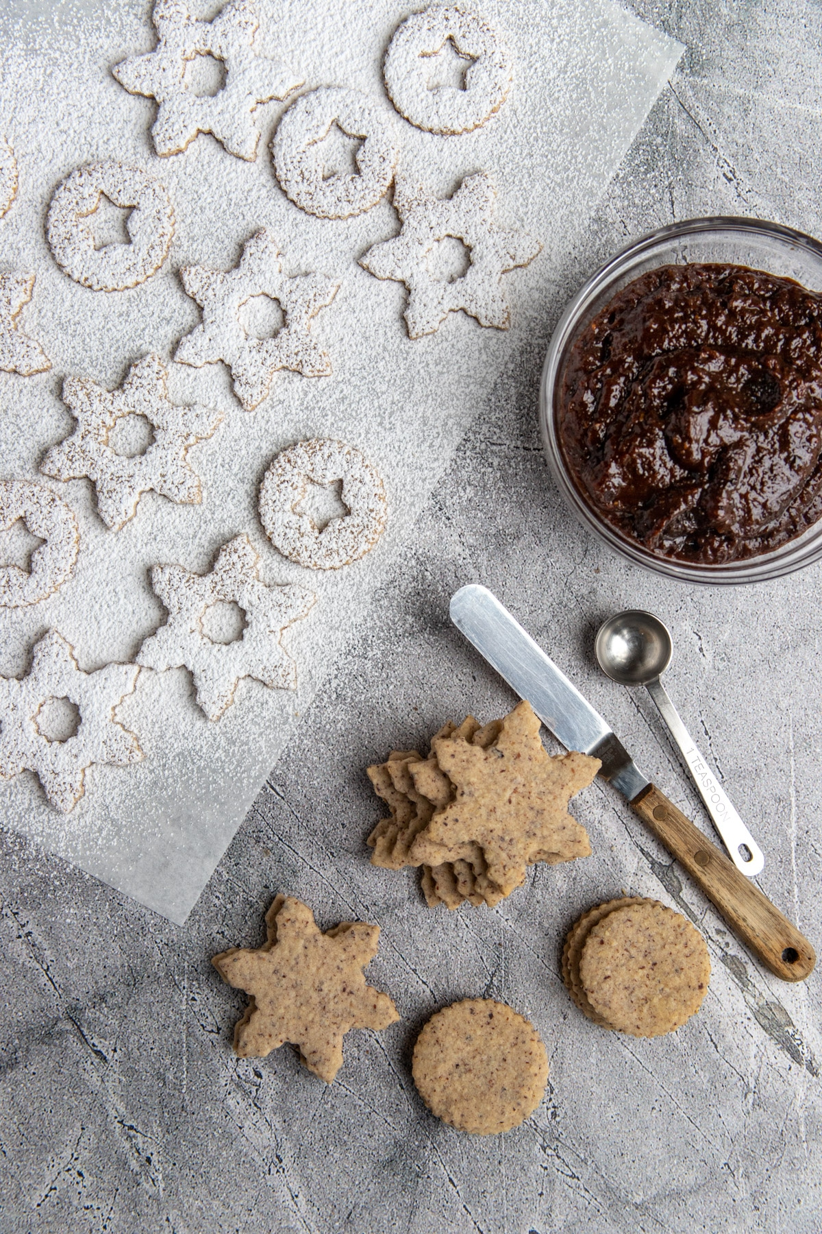 Hazelnut and Prune Jam Linzer Cookies covered with powdered sugar