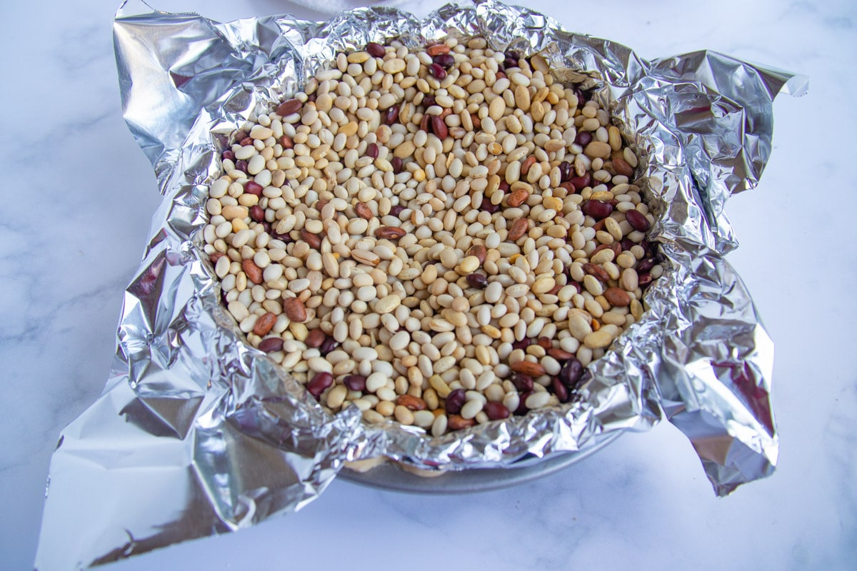 Pie dough covered with foil and dry beans