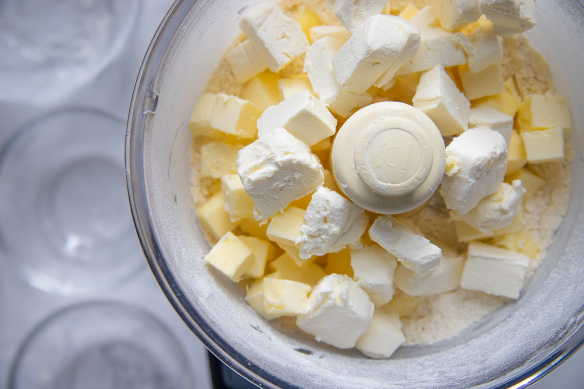 Flour, sugar, butter and cream cheese in the food processor bowl