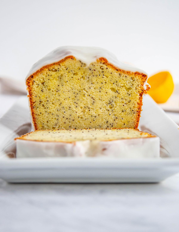 Meyer Lemon Poppy Seed Cake with Lemon Glaze on a white platter