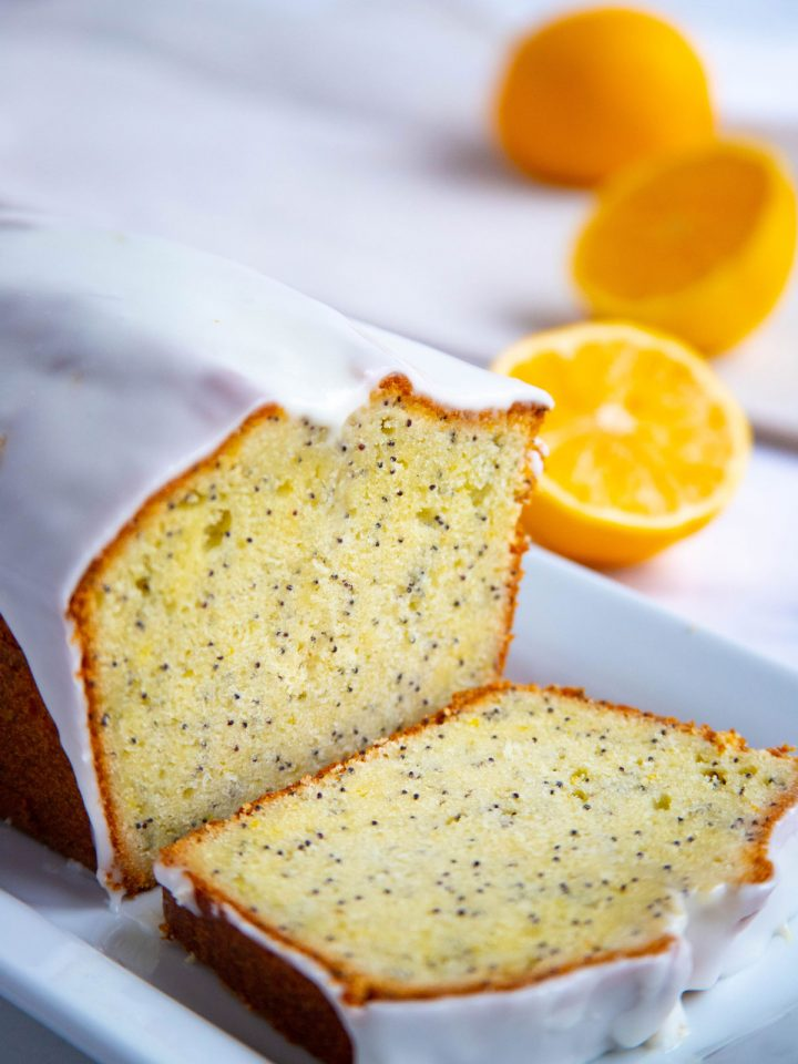 Meyer Lemon Poppy Seed Cake with Lemon Glaze on a white plate