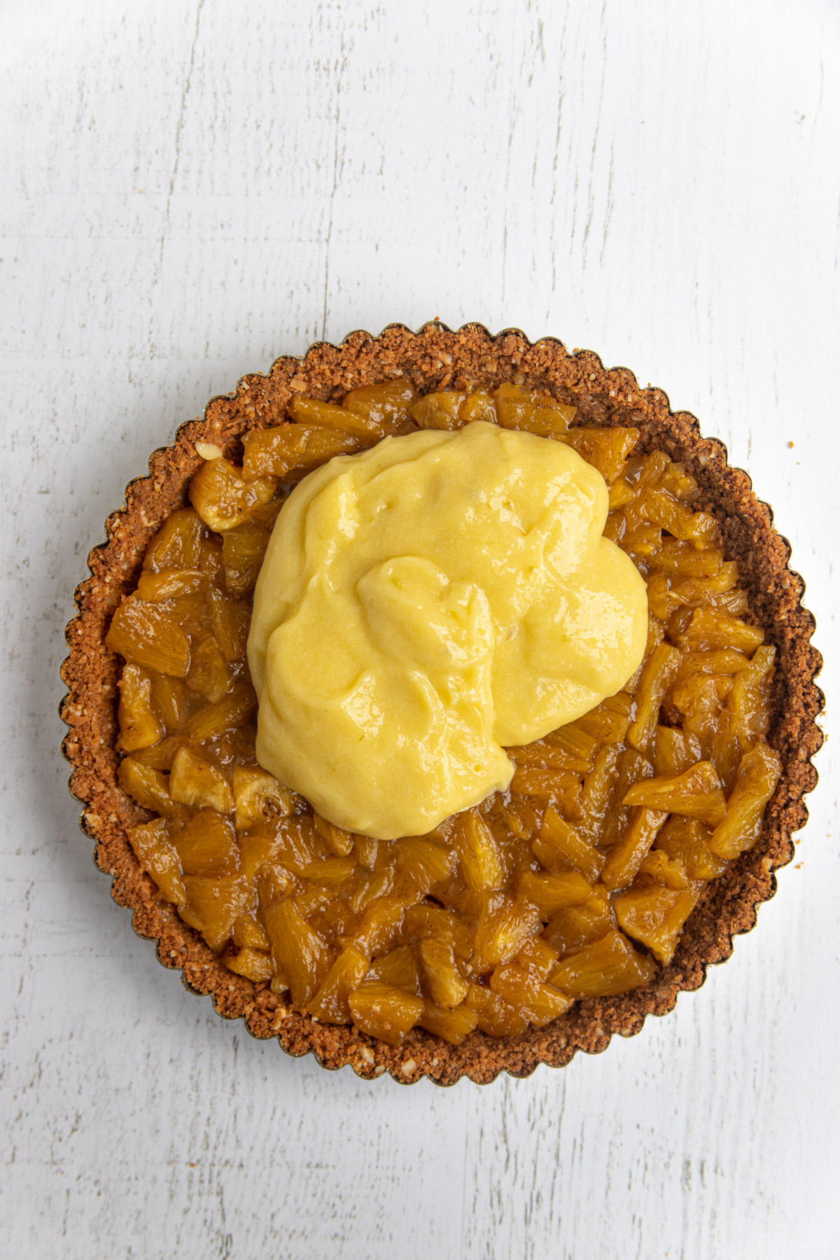 Cookie Crust filled with the Roasted Pineapple and some of the lime curd added on top
