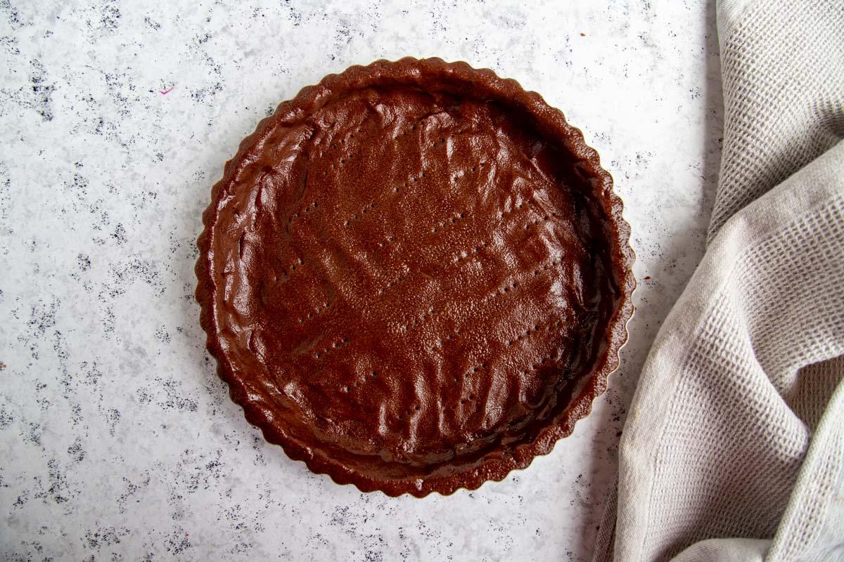 Chocolate Tart Dough Pressed Into Tart Pan
