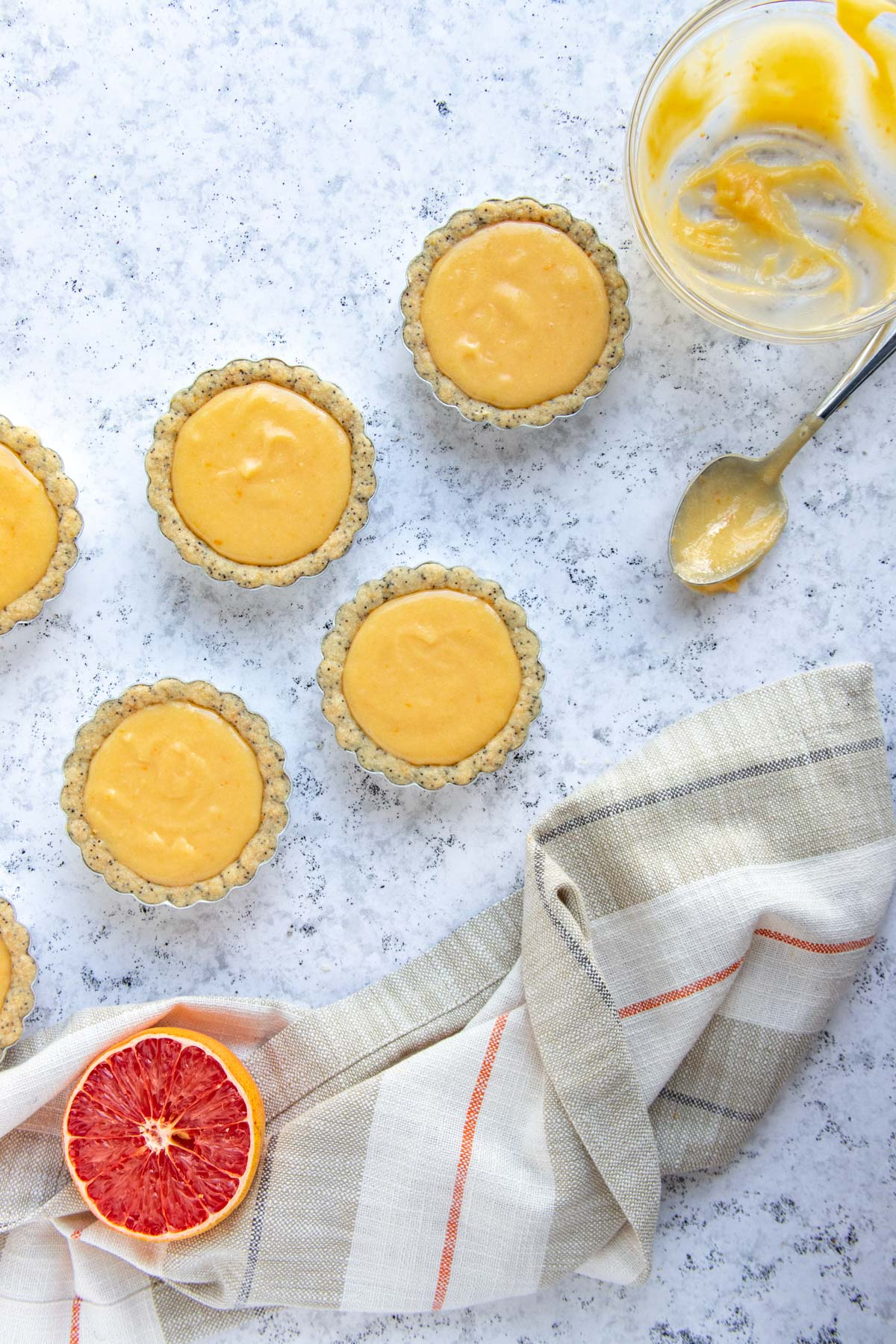 Baked lemon poppy seed tart crusts filled with grapefruit curd