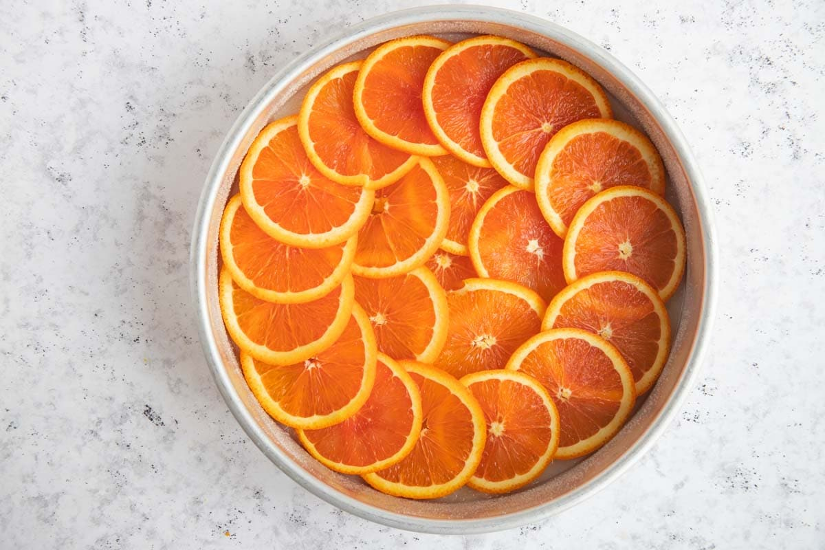 Can pan with the melted butter and sugar and all the orange slices arranged on top of sugar in a spiral pattern