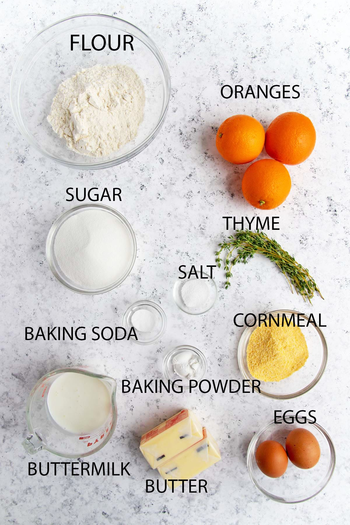 Orange upside down cake ingredients - Flour, fresh oranges, thyme, cornmeal, salt, eggs, butter, buttermilk, baking powder, baking soda, sugar