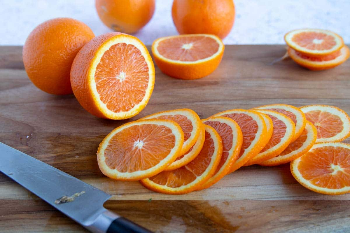 Cara Cara orange slices on a wooden cutting board