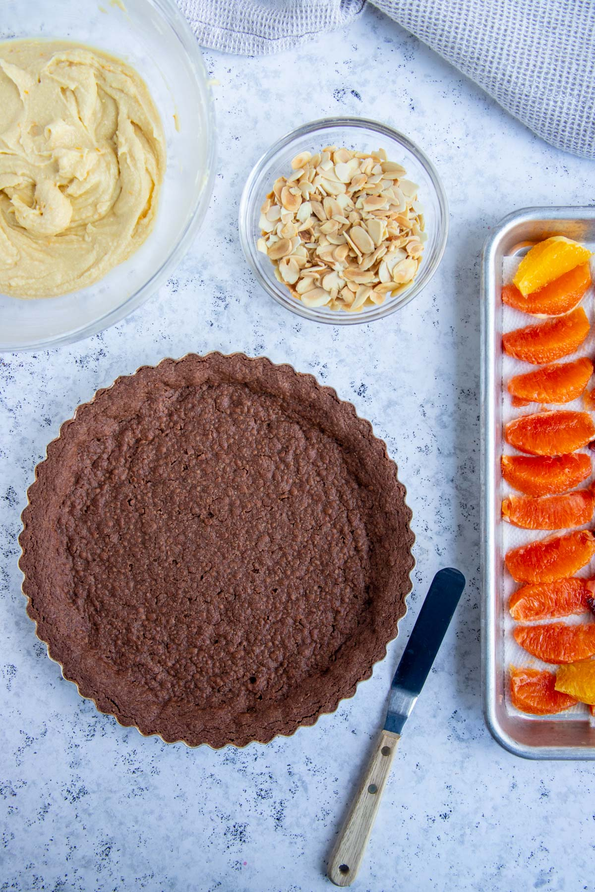 Baked Chocolate Tart, Orange Slices, Toasted Almonds and Almond Cream