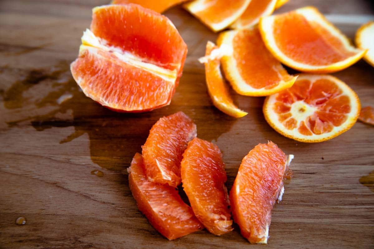 Orange with orange peel and orange slices