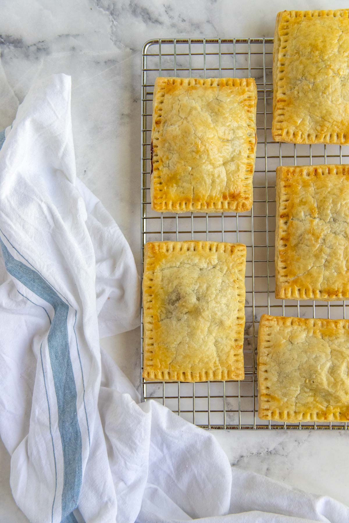 Baked blackberry hand pies on a cooling rack without the glaze
