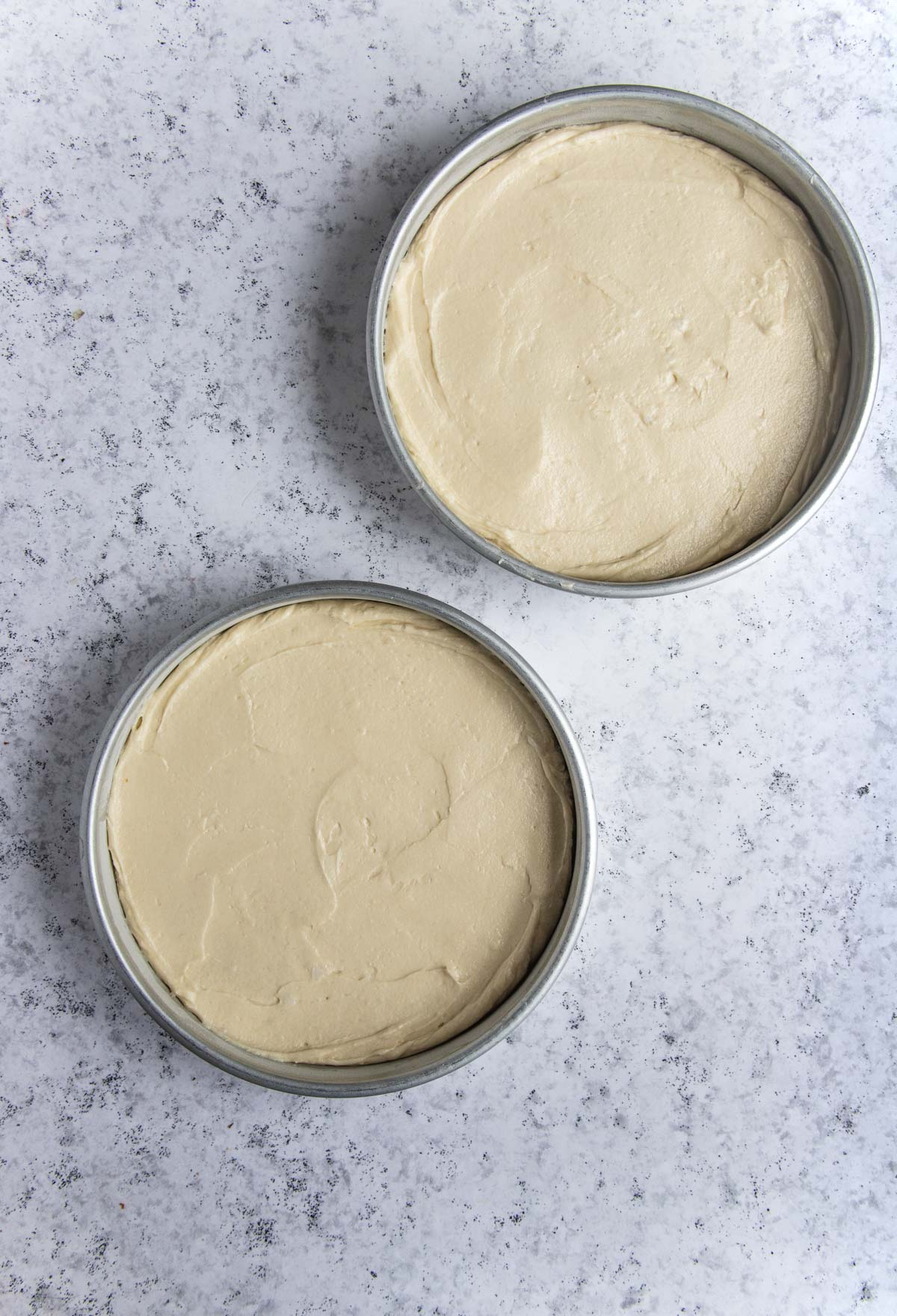 The cake batter measured into two 9-inch round cake pans