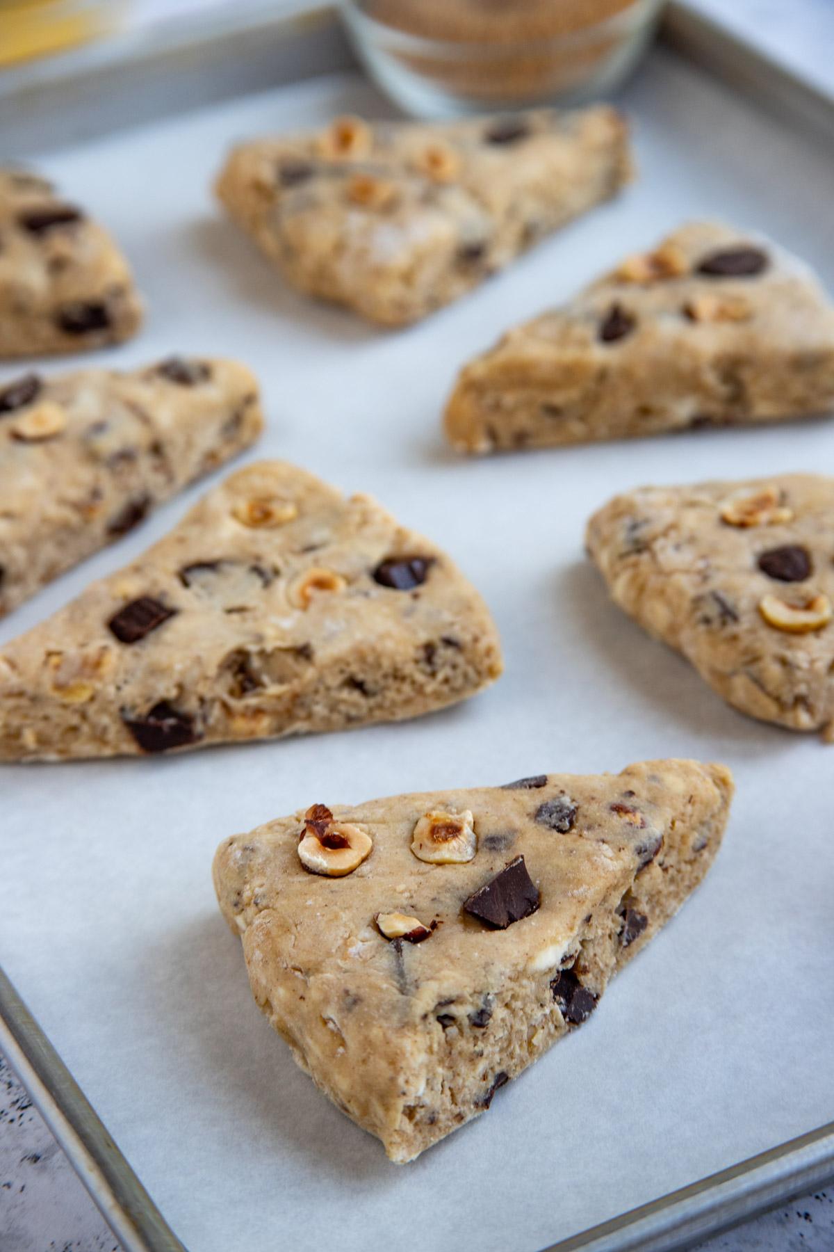 Unbaked chocolate hazelnut scones on a baking sheet