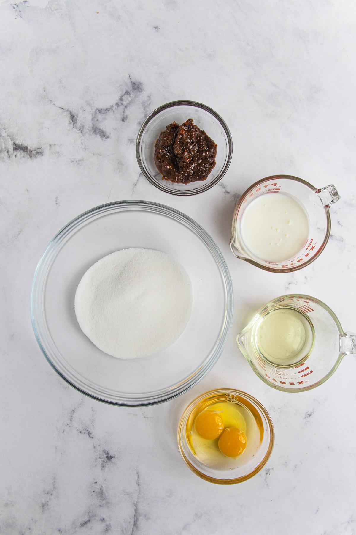 Raspberry Prune Bread wet ingredients - prune puree, buttermilk, vegetable oil. eggs and sugar