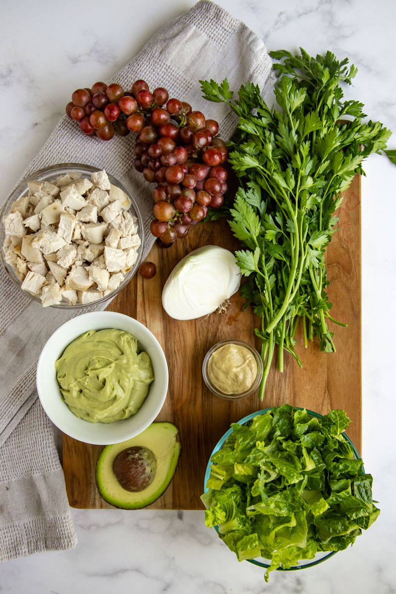 Avocado Chicken Salad Ingredients - Avocado Caesar Dressing, Fresh Avocado, Romaine Lettuce, Dijon Mustard, Onion, Parsley, Red Grapes, Chicken