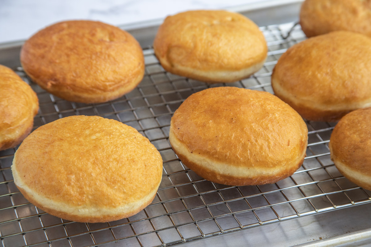 Fried Yeast Raised Doughnuts on a Cooling Rack