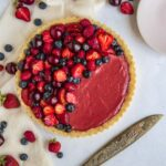 Strawberry and White Chocolate Tart with dessert plates and cutting knife