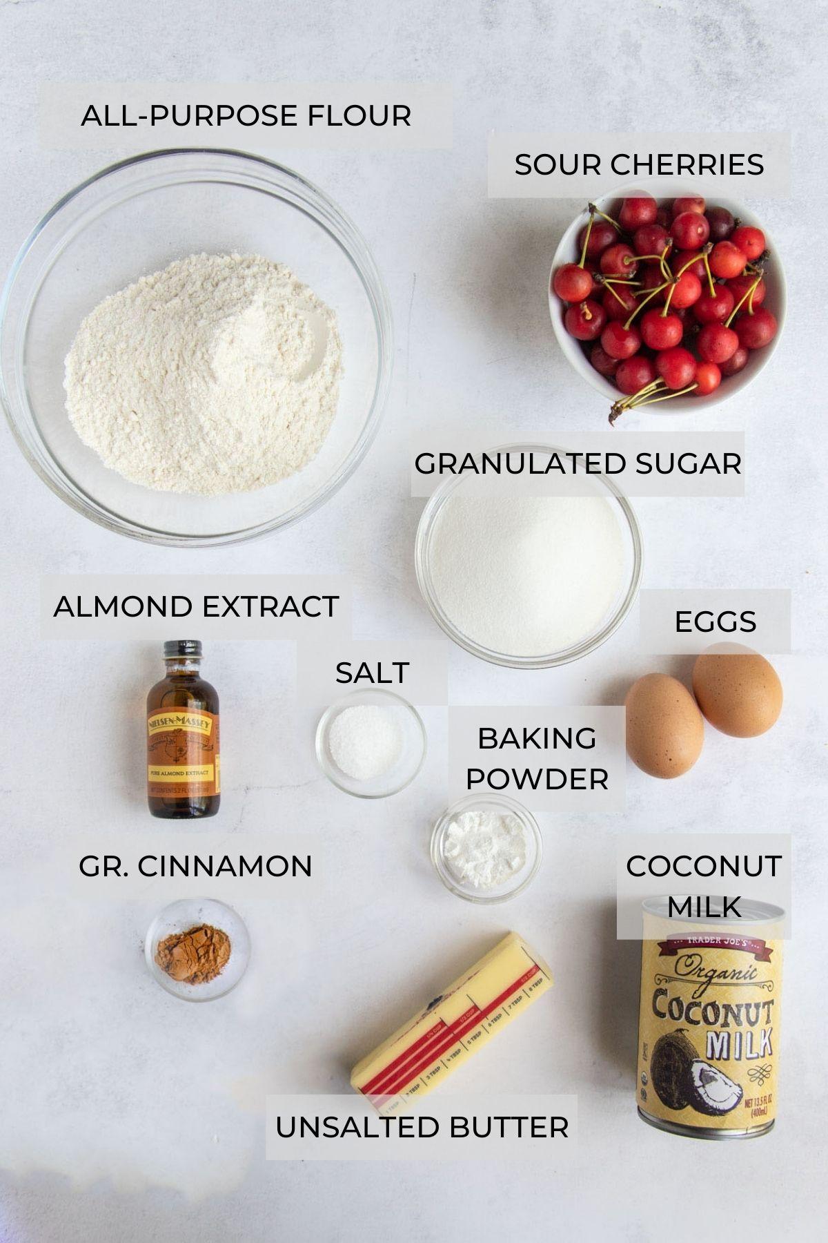 Cherry Coconut upside down cake ingredients - all-purpose flour, sour cherries, sugar, eggs, baking powder, coconut milk, unsalted butter, ground cinnamon, almond extract and kosher salt