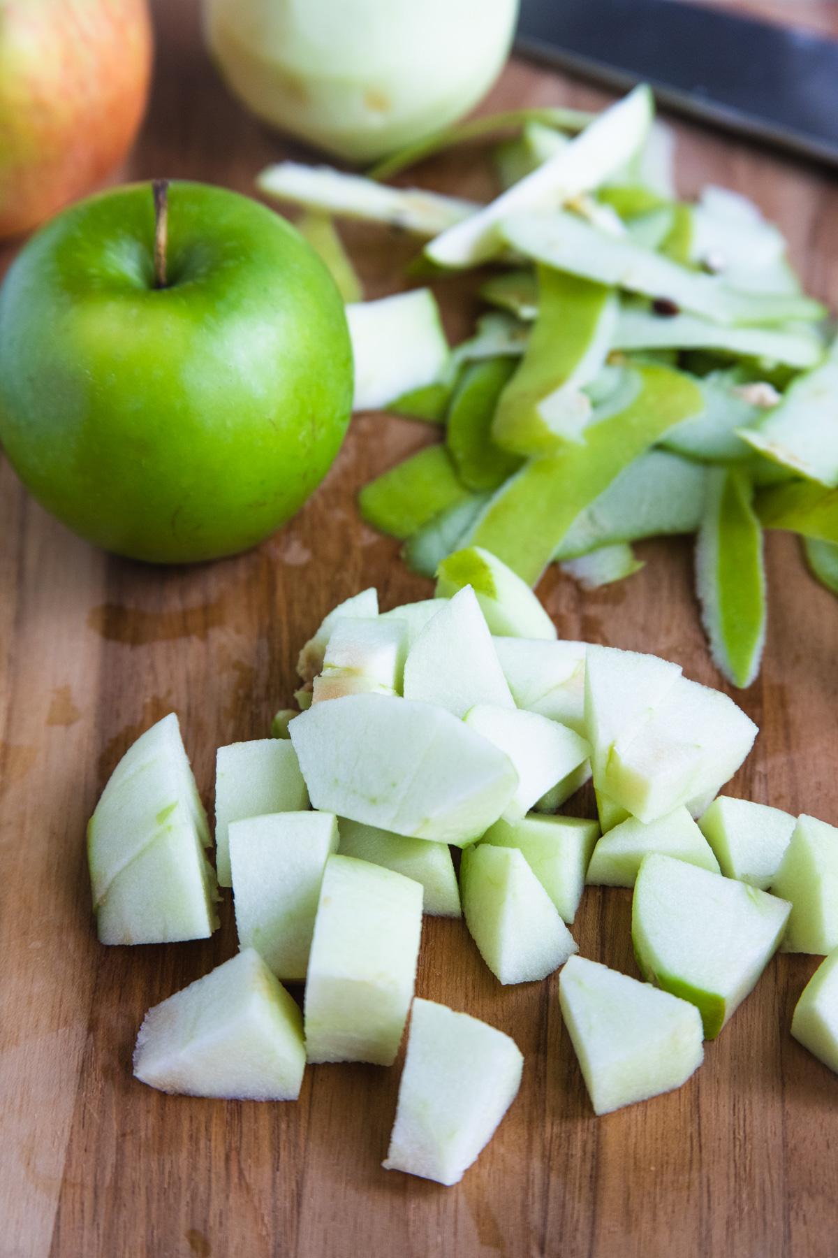 Granny Smith Apple on a cutting board cut into 1-inch chunks