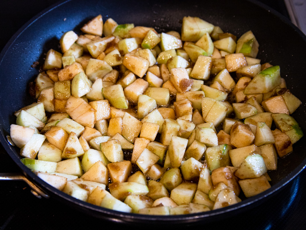 Apples cooking in a nonstick pan