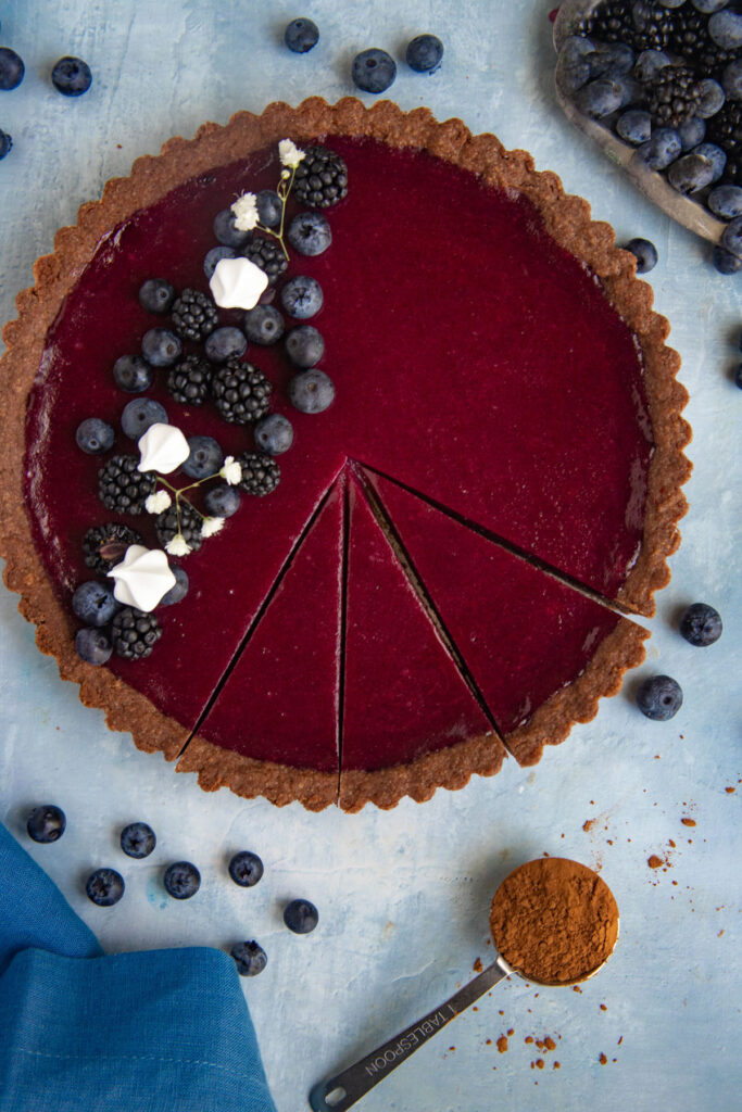 Blueberry Curd Tart decorated with fresh blueberries and blackberries