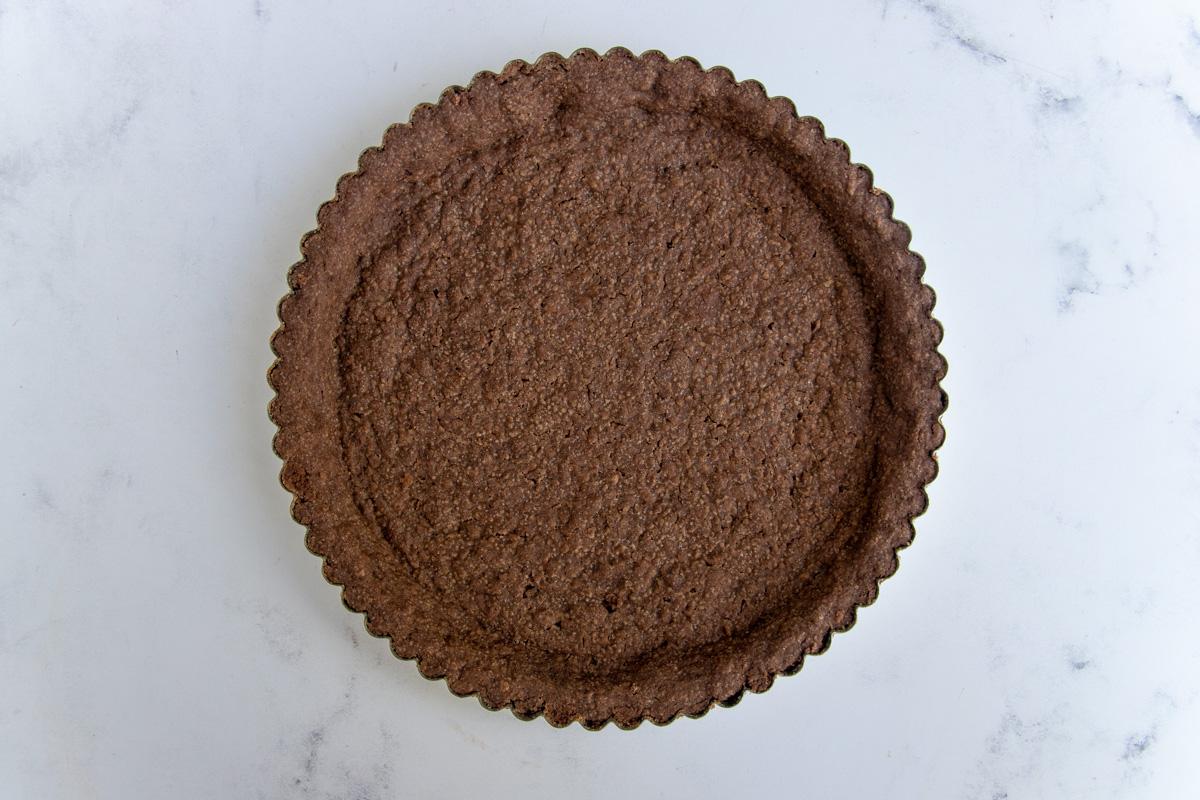 Baked chocolate cookie tart crust.
