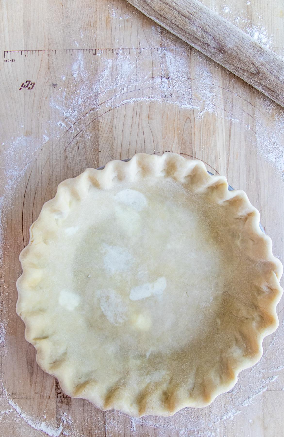 Pie dough shaped in pie pan